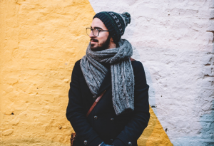 man with knitted scarf