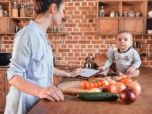 mom cooking in kitchen with baby